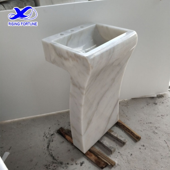 White marble pedestal bathroom basin