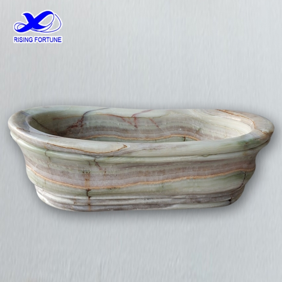 Honed green onyx bathtub