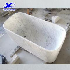 rectangular white marble bathtub